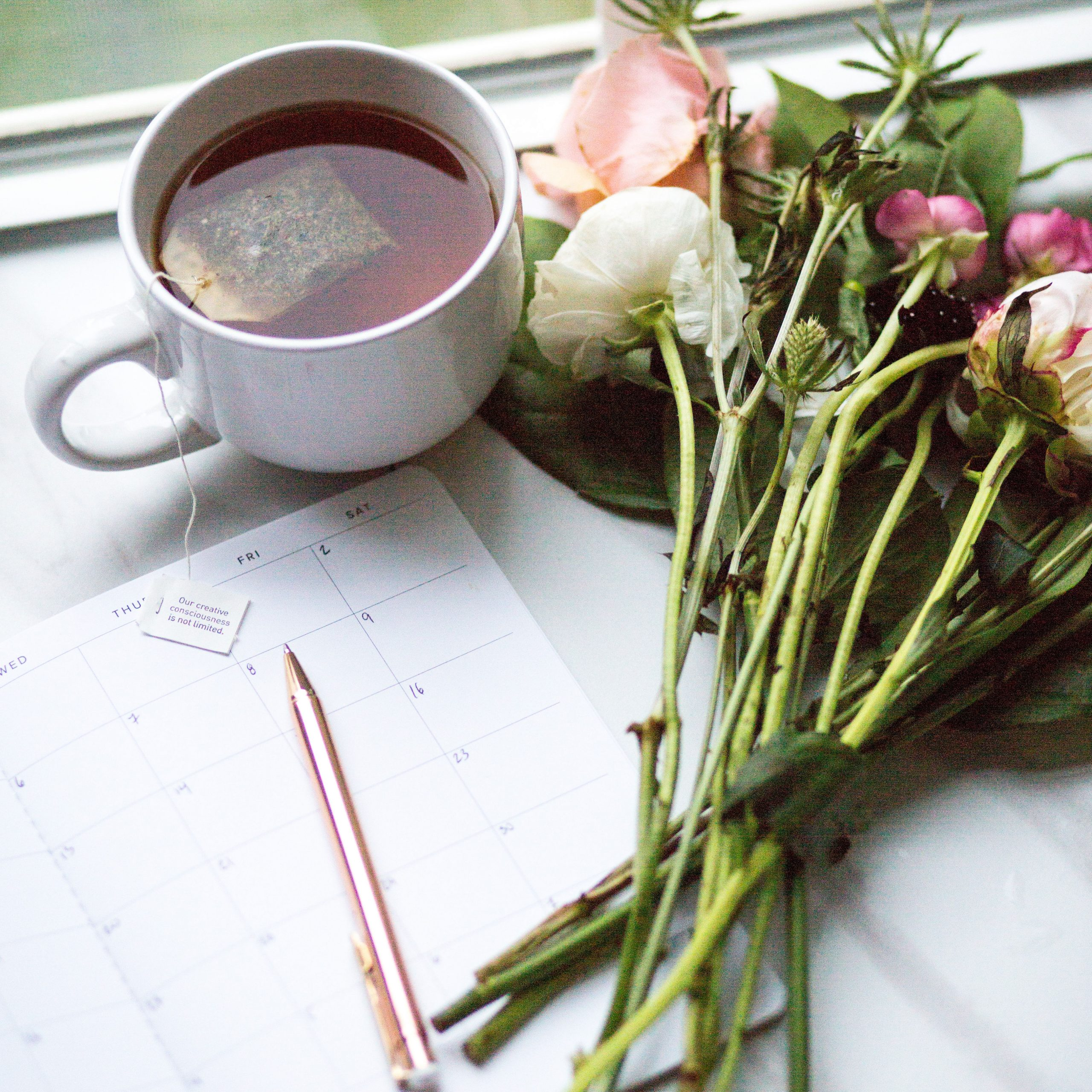 Coffee, calendar,and roses
