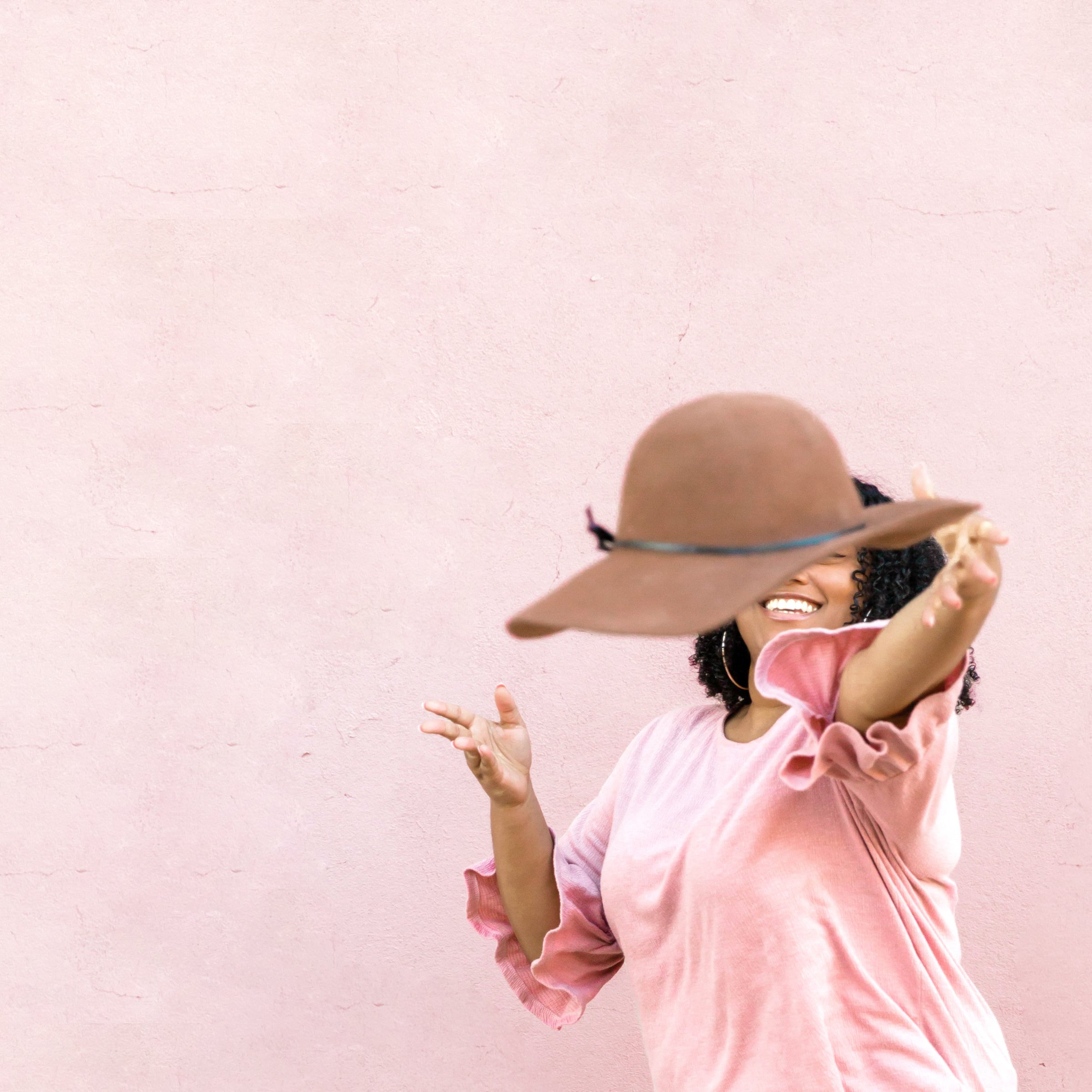 Woman tossing hat