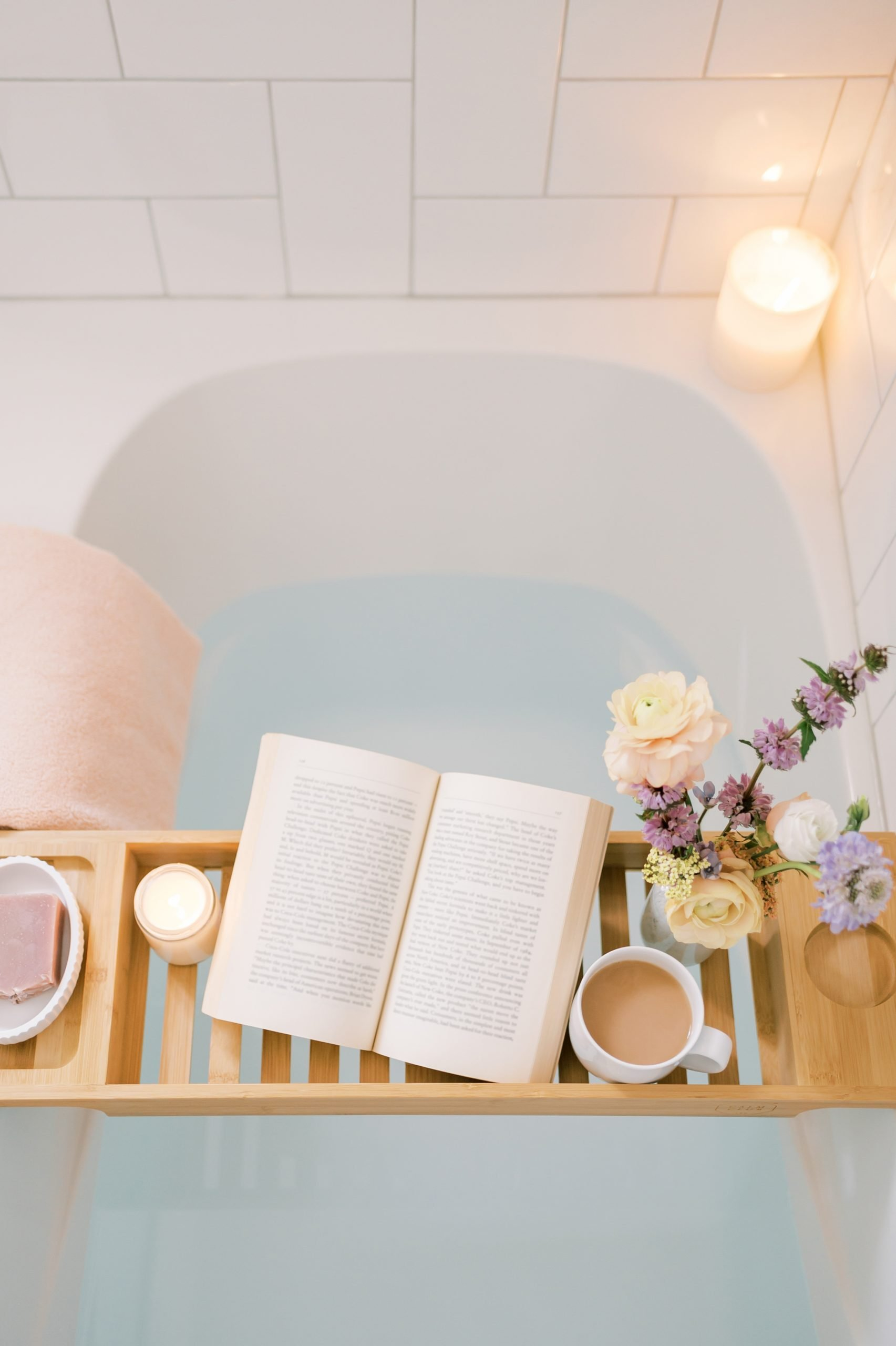 Drawn bath with book and coffee on a tray